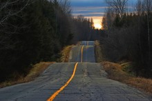 Sunset Light On Bumpy Country Road