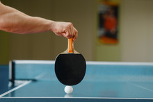 Male Person Hand With Racket And Ping Pong Ball
