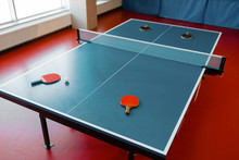Ping Pong Rackets On Game Tabl...