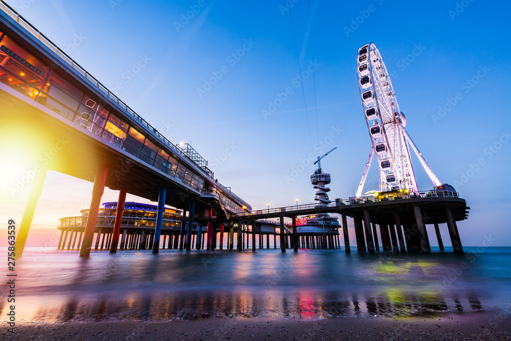 Fototapety, obrazy: Colorful blue hour sunset on coastline, beach, pier and ferris wheel, Scheveningen, the Hague.