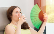 Woman Drinking Water And Fanning