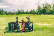 Golfing Bags With Clubs On Gol...