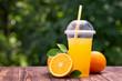 orange juice in plastic cup