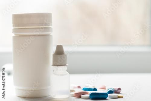 Valokuvatapetti blue and white pills medicine on white background.