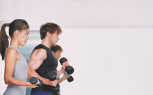 Gym Training Fitness People Lifting Weights In Weightlifting Group Class In Studio.