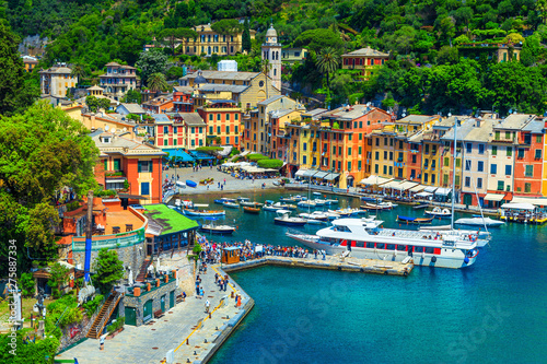 Mediterranean Portofino village with tourists in harbor, Liguria, Italy