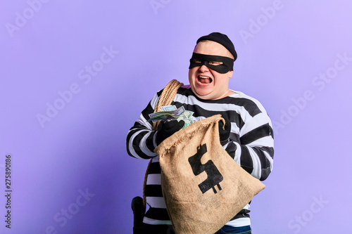 rich prisoner in striped uniform expresses his positive emotion and happiness Obraz na płótnie