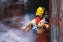 Firefighter Holding Child Boy ...