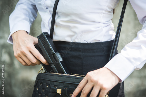 Photo  Young woman with concealed weapon