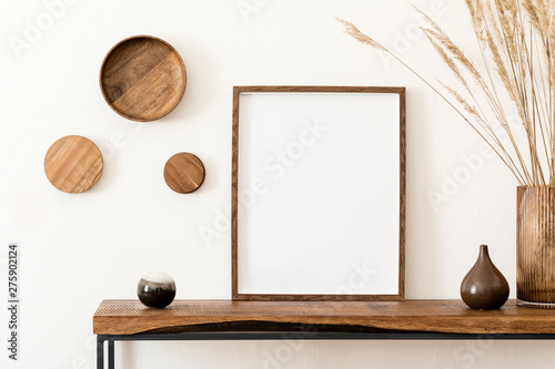 Fényképezés Design scandinavian interior of living room with wooden console, rings on the wall, mock up poster frame, flowers in vase and elegant personal accessories