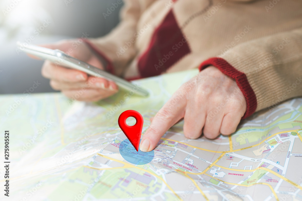 Fototapety, obrazy: hand on the map with gps signal and location