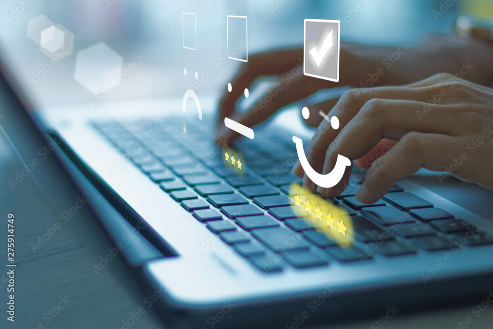 Fototapety, obrazy: Businesswoman pressing face emoticon on the keyboard laptop .Customer service evaluation concept. Blue tone