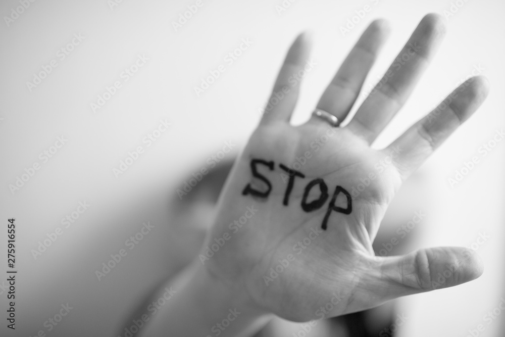 Fototapety, obrazy: Woman shows palm with the inscription on the palm