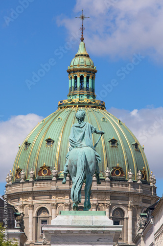 Photo  18th century Marble Church and statue of King Frederik V on a background of blue