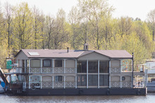 Large Private House On The Water. Mobile Floating Two-story House On The River. Apartments In A Residential Building On The River. Floating House With The Possibility Of Towing. Boat House.