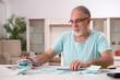 Leinwandbild Motiv White bearded old man in budget planning concept