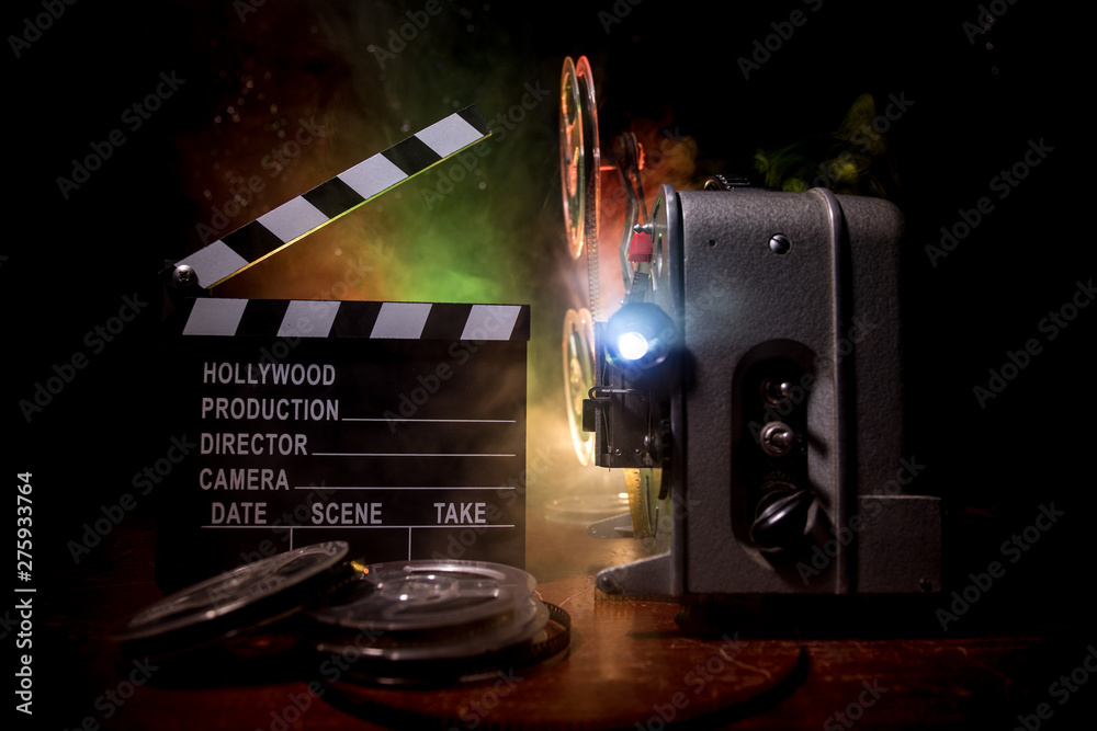 Fototapety, obrazy: Old vintage movie projector on a dark background with fog and light. Concept of film-making.