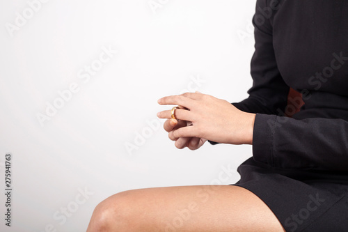 Fototapeta partial view of lawyer and client sitting at table with divorce decree and wedding rings obraz na płótnie