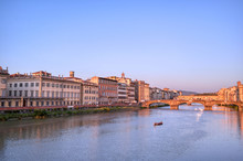 A View Of The Arno River And The Ponte Vecchio In Florence, Italy.
