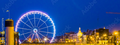 skyline of antwerp city with the ferris wheel lighted at night, Antwerpen, Belgium