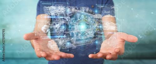 Photo  Businessman using wireframe holographic 3D digital projection of an engine