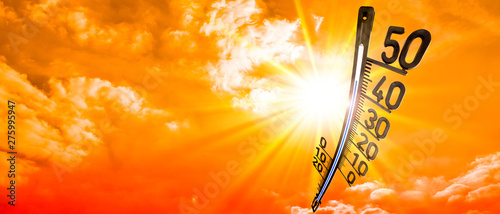 Fotografie, Obraz Hot summer or heat wave background, glowing sun on orange sky with thermometer