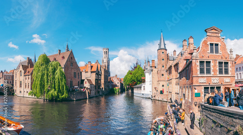 Wall Murals Bridges Panoramic city view with Belfry tower and famous canal in Bruges, Belgium.