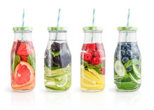 Infused Water With Fresh Fruits, Vegetables And Berry In Bottles