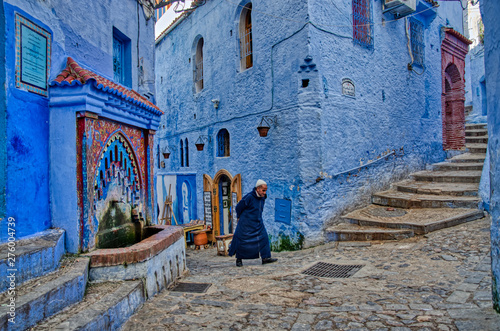 Foto op Canvas Marokko Rear View Of Person Walking In Alley Amidst Houses