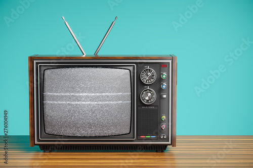 Valokuva An old TV with a monochrome kinescope on wooden table. 3d