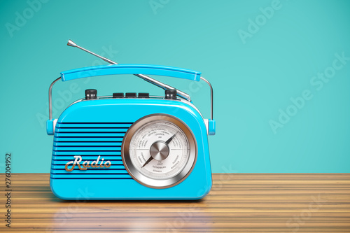 Cuadros en Lienzo Vintage blue radio receiver on wood table. Wallpaper 3d