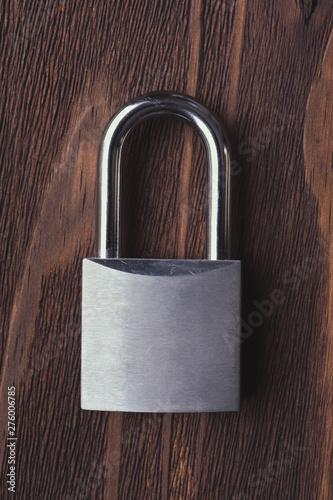 metal padlock on rustic wood