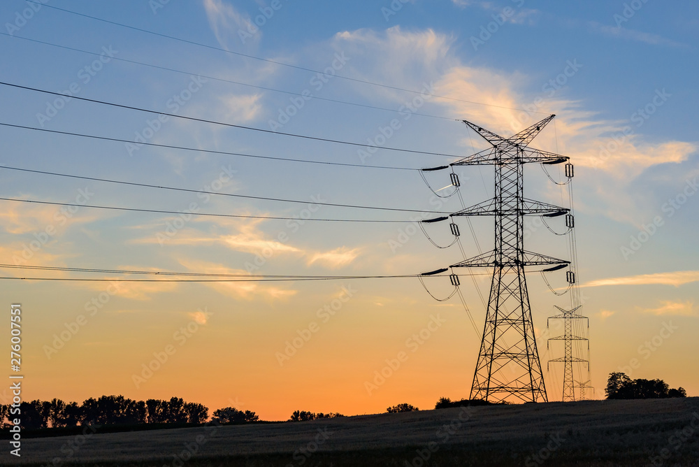 Fototapety, obrazy: Electricity pylons and high voltage power lines at sunset