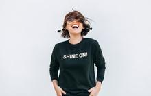 Free Feeling Happy Woman Posing In Black Sweatshirt With Positive Print Shine On