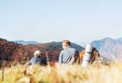 Türaufkleber Weiß Father and son travelers rest together in mountain valley with beautiful hills view
