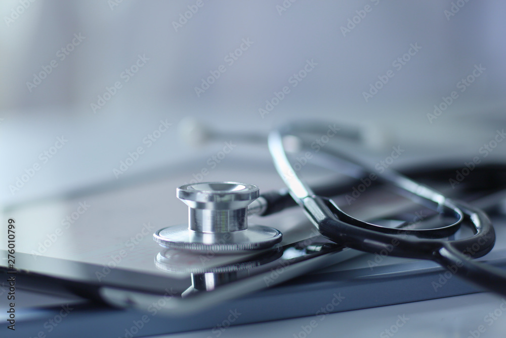 Fototapety, obrazy: Medical equipment: blue stethoscope and tablet on white background. Medical equipment