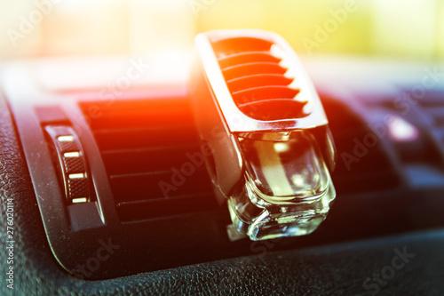 Fotografia, Obraz  Air freshener in the car, black interior, car deflectors, sunlight shines throug