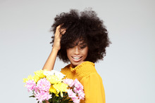 Young Beautiful Afro Girl With Flowers.