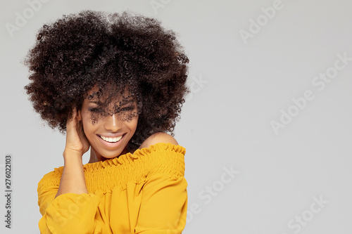 Happy afro woman with beautiful smile. Wallpaper Mural