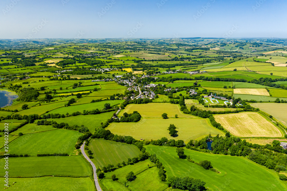 Fototapeta Aerial drone view of green fields and farmland in rural Wales