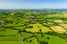 Aerial Drone View Of Green Fields And Farmland In Rural Wales