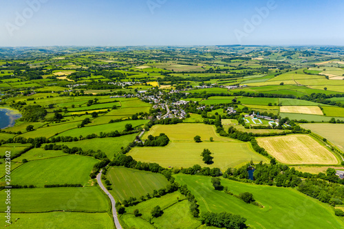 Fototapeta Aerial drone view of green fields and farmland in rural Wales obraz