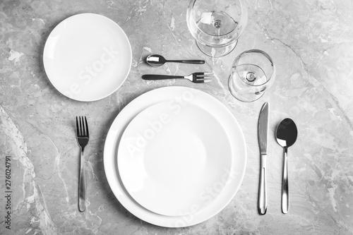 Obraz Stylish elegant table setting on grey marble surface, top view - fototapety do salonu