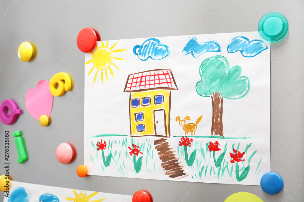 Fototapeta Child's drawing and magnets on refrigerator door as background