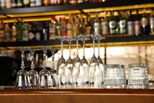 Different Empty Clean Glasses On Counter In Bar