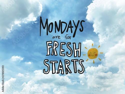 Fototapeta Mondays are for fresh starts word lettering and sun smile on blue sky background