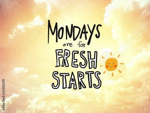 Valokuva  Mondays are for fresh starts word lettering and sun smile on golden sky backgrou