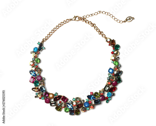 Foto Stylish necklace with gemstones isolated on white, top view
