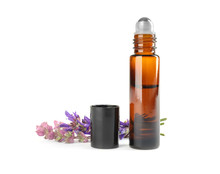 Bottle Of Herbal Essential Oil And Sage Flowers Isolated On White