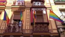 Rainbow LGBT Flag Waves Agains...